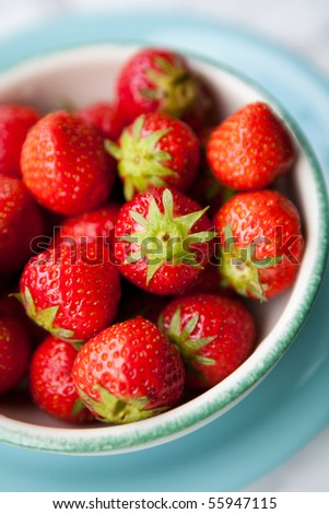 Close-up of fresh, juicy strawberries in a bowl - stock photo