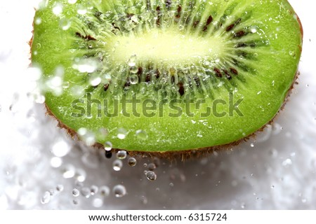 close up of fresh kiwi under the water - stock photo