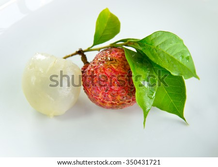 Close up of fresh lychee isolated on white background, selective focus. - stock photo