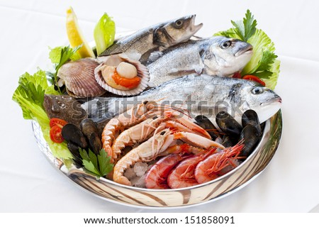 Close up of fresh mediterranean seafood on ice. - stock photo