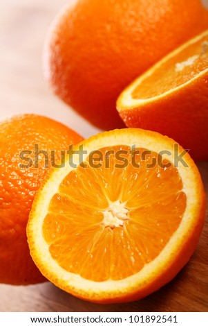 Close up of fresh oranges on wooden board - stock photo