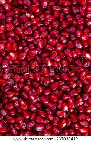 Close up of fresh organic pomegranate seeds - stock photo