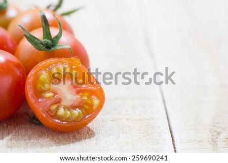 Close-up of fresh, ripe cherry tomatoes on wood BackGround - stock photo