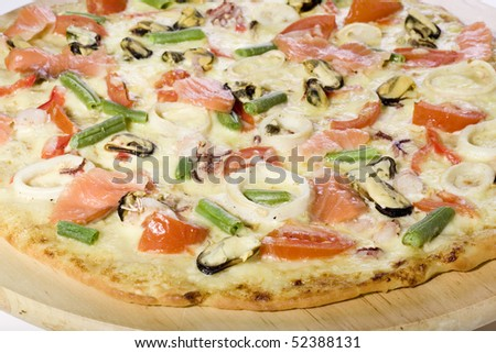 Close up of fresh Seafood pizza - stock photo