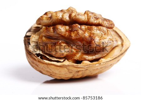 Close up of fresh walnut against white background - stock photo