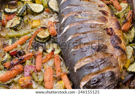 close-up of freshly baked wild salmon with vegetables - stock photo