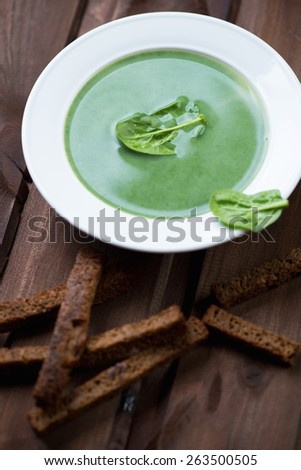 Close-up of freshly made spinach soup, studio shot - stock photo