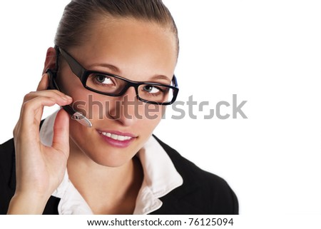 Close up of friendly female phone operator in call centre talking with headset to provide customer service, isolated on white background. - stock photo
