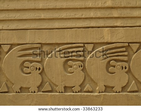 Close up of frieze on adobe wall at the ancient city of Chan Chan, remains of the Chimu empire. Located outside the modern city of Trujillo, northern Peru, South America. - stock photo
