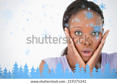 Close up of frightened woman on white background against snowflakes and fir trees in blue