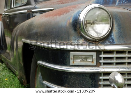 Close up of front fender and headlight of antique car - stock photo