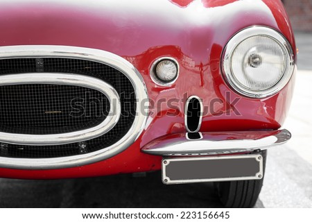 close up of front of a red vintage car - stock photo