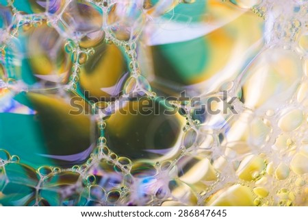 Close up of froth, abstract background. Air bubbles in soap foam. - stock photo