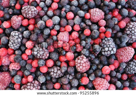 Close up of frozen mixed fruit  - berries - red currant, cranberry, raspberry, blackberry, bilberry, blueberry, black currant - stock photo