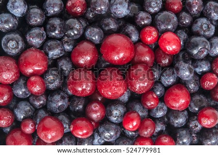 Close up of frozen mixed fruit - blueberries, cranberries and cherry