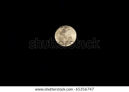 Close-up of full moon on black background, Thailand. - stock photo