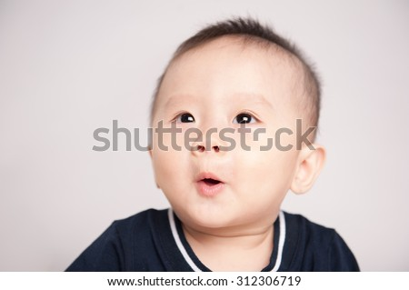 Close up of funny baby with tongue sticking out