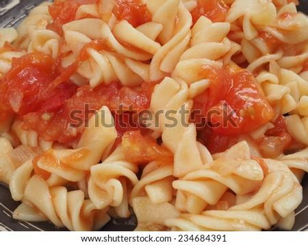 close up of fusilli pasta with tomato sauce - stock photo
