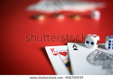 Close up of game card with dice on red table with copy space. - stock photo