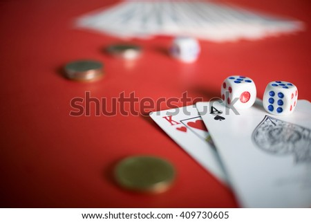 Close up of game card with dice on red table with copy space.
