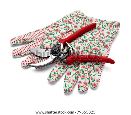 close up of  gardening scissors and gloves on white background with clipping path - stock photo