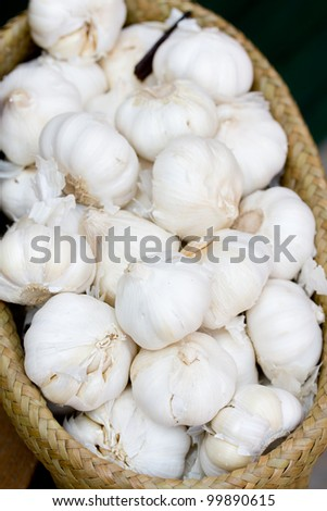close up of garlic in basket