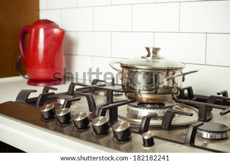Close-up of  gas stove with a pan in traditional kitchen - stock photo