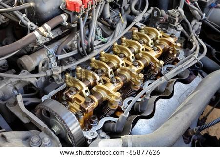 Close up of gasoline car engine,  three valve per cylinder  system - stock photo