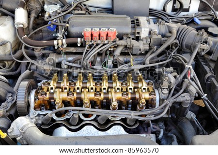 Close up of gasoline car engine,  three valve per cylinder  system  LPG converted - stock photo