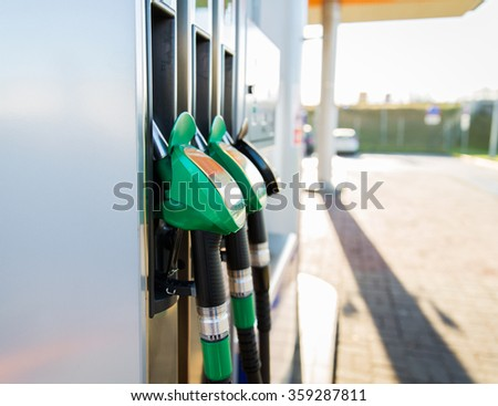 close up of gasoline hose at gas station - stock photo
