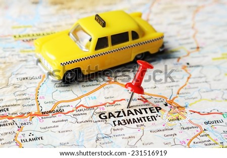 Close up of  Gaziantep ,Turkey  map with red pin and a taxi    - Travel concept - stock photo