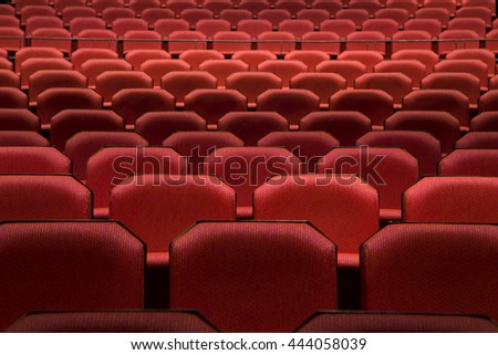 Close up of generic red theater seats - stock photo