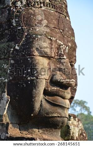 Close up of giant face at Bayon Temple, Angkor Wat, Siem Reap, Cambodia - stock photo