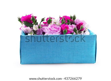 Close Up of gift box with flowers on a white background - stock photo