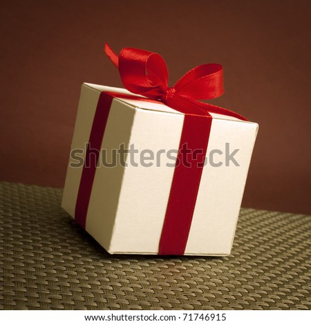 Close up of gift box with red bow - stock photo