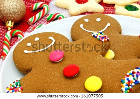 Close up of Gingerbread Men in a plate with decor     - stock photo