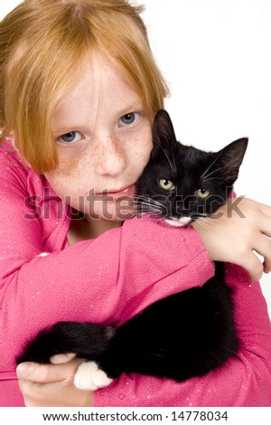 close up of girl and kitten - stock photo