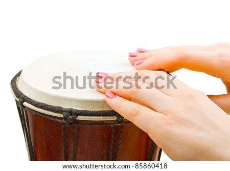 Close-up of girl drummers hands playing percussion isolated on white background - stock photo