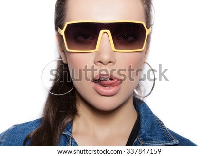 Close-up of girl in a sunglasses on white background not isolated