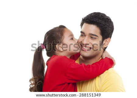 Close-up of girl kissing her father - stock photo