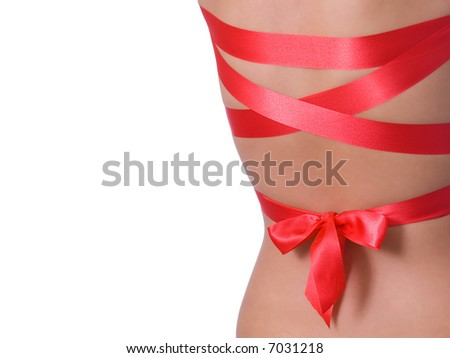 Close  up  of girl's  back with red ribbon - stock photo