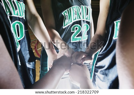 Close up of girl's hands in team huddle - stock photo