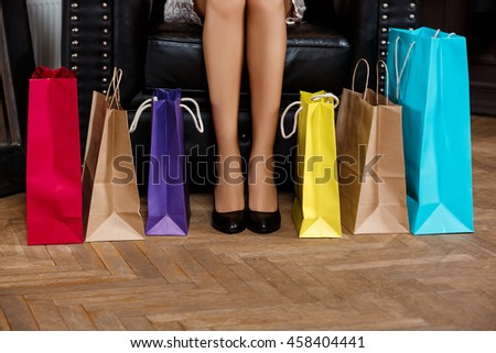 Close up of girl's legs in heels and buyings.