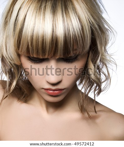 Close-up of girl with shiny hair highlights and lowlights