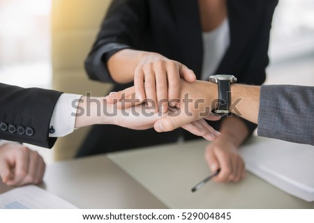 Close up of giving a high five, guarantee between potential partners, decide on marketing strategy for mutual business, profitable family business idea, running a business together. Teamwork concept