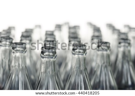 Close up of glass bottles arranged many, Rows of empty glass bottle neck - stock photo