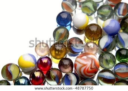 Close-up of glass marbles on white - stock photo