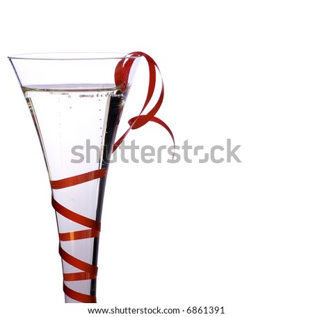 Close up of glass of champagne decorated red ribbon - stock photo
