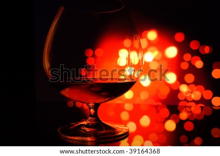 close-up of glass with copyspace and abstract lights background - stock photo