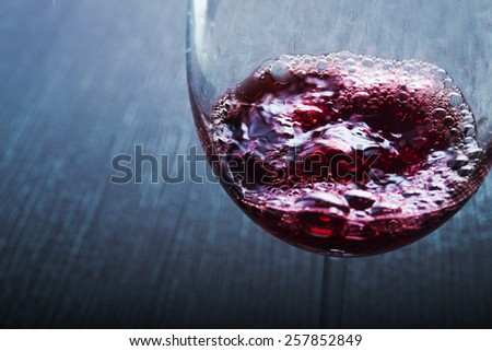 Close up of glass with red wine - stock photo